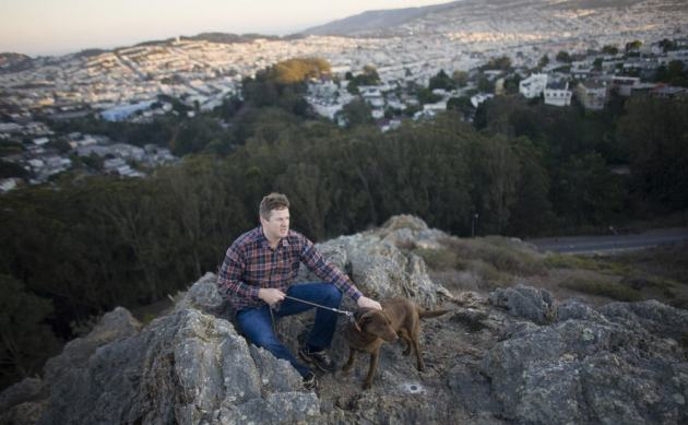 Owen Randall on rocky outcrop near home